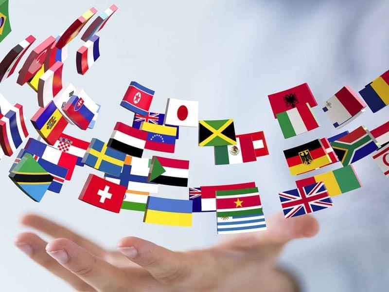 hand juggling many international flags